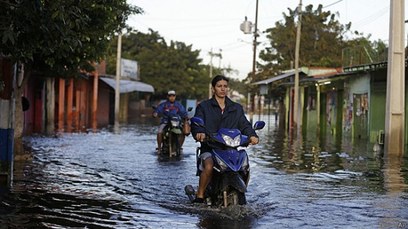 Floods caused by intense unseasonal rainfall hit many parts of Paraguay in June and July, with the capital Asunción particularly badly hit. Photo courtesy of AP.
