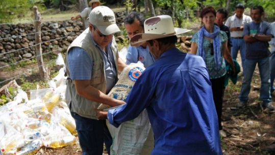 honduras drought farmer receives bag of provisions wfp reuters